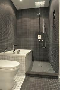 Grey and white tile work all over the bathroom gleams it up