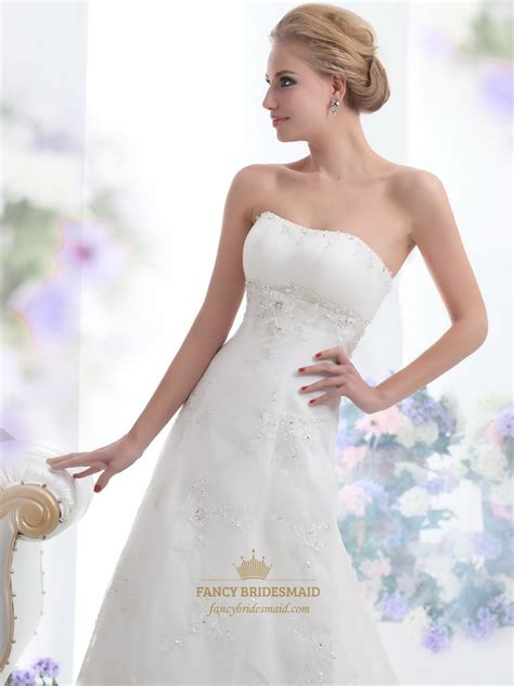 Empire Of Ivory ivory strapless empire tulle wedding dresses with beaded