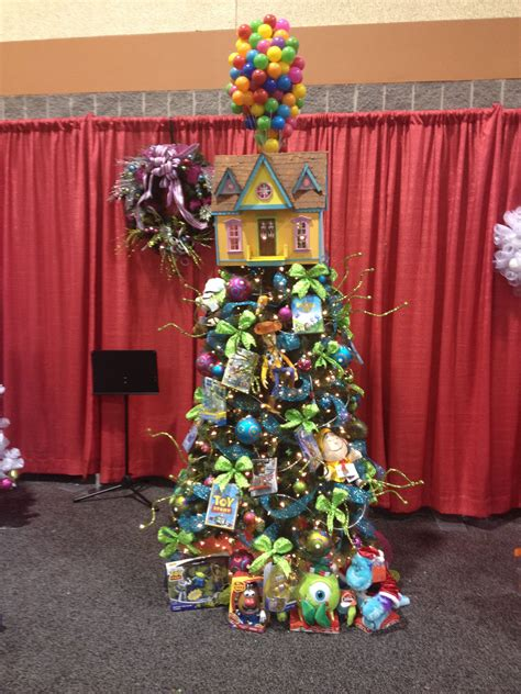 disney tree toppers for christmas trees disney pixar themed tree up balloon house tree topper house