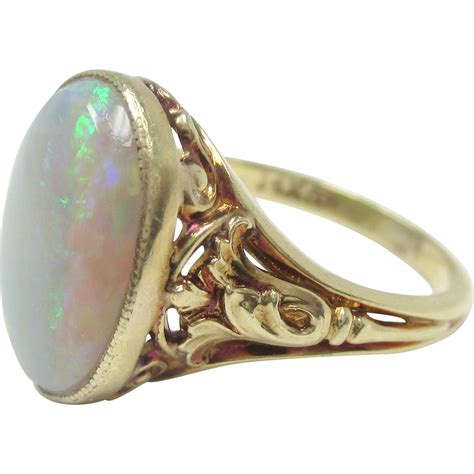 beautiful 14k yellow gold opal ring from prestige