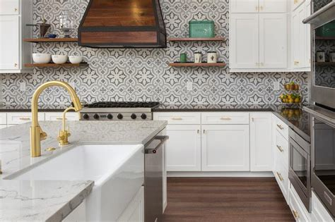 concrete tile backsplash white island cabinets with brass pulls transitional kitchen