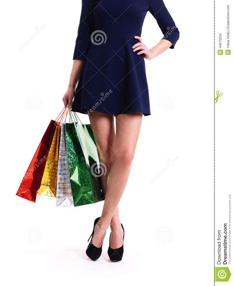 high heels shopping in high heels with color shopping bags stock photo