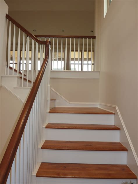 big white staircase beautiful wooden floors high laminate flooring practically renovating