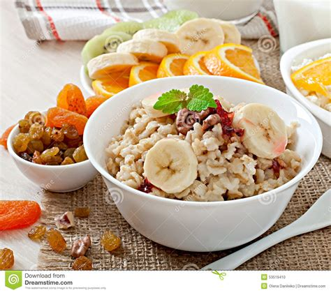 oatmeal cottage cheese milk and fruit stock photo