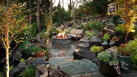 backyard landscaping with pit lush garden and gray patio alderwood landscaping