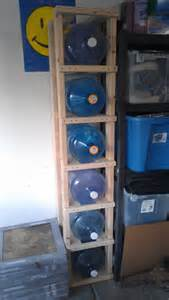 i seven 5 gallon water jugs that i use to top my