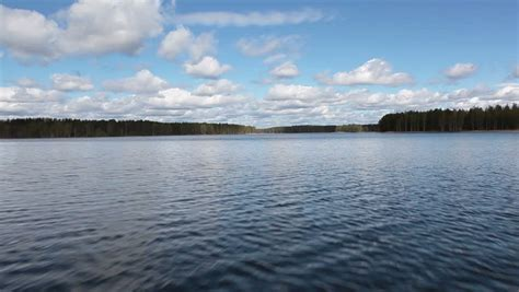 fast moving boats fast moving boat on beautiful forest lake in karelia