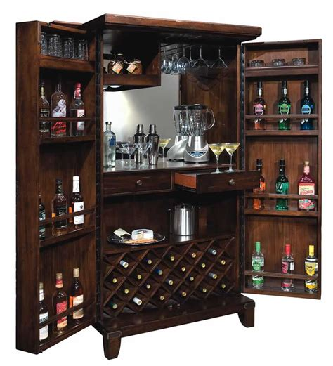 howard miller bar cabinets howard miller 695122 rogue hide a bar wine spirits storage