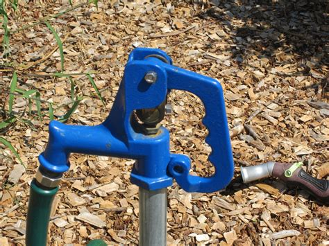 Outside Water Faucet Leaking From Handle by Well Spigot Images