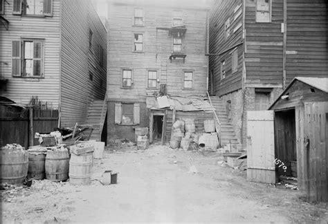 backyard new york 25 haunting photos of life inside new york s tenements