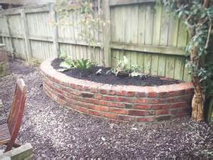 reclaimed brick planter retaining wall blue slate path