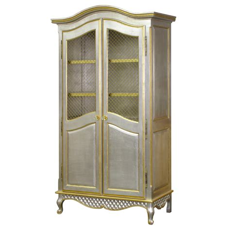 silver armoire grand armoire in silver and gold gilding with brass wire