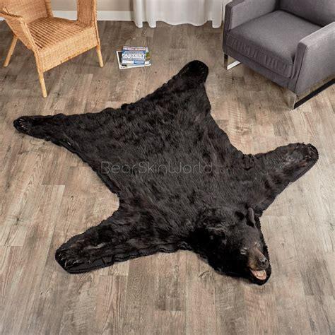 on a bearskin rug 5 foot 8 inch 173cm black rug 0603532