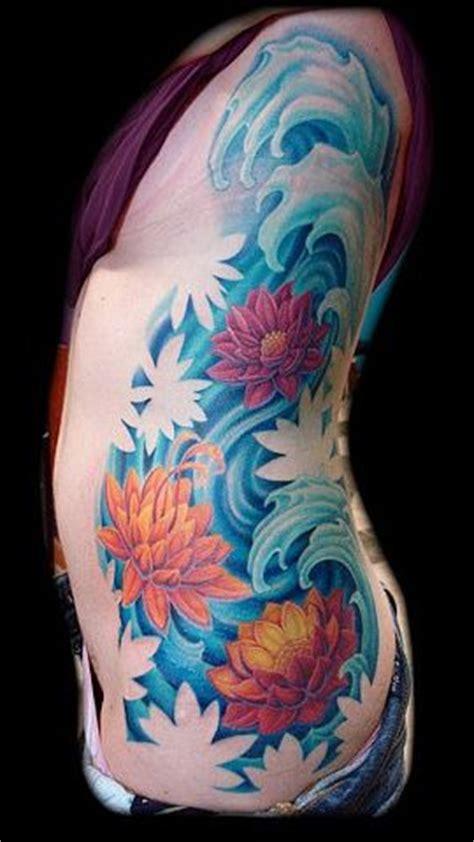 lotus universe tattoo tattoo water lotus flowers waves tattoos color large