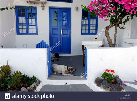 blue house with a blue window view of a santorini whitewashed house with blue windows blue door stock photo