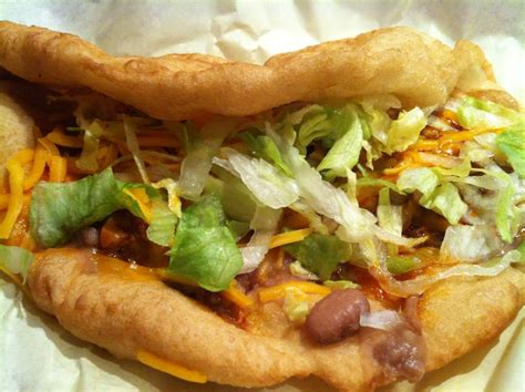 fry bread house ultimate taco refried beans w spicy red chili beef diced onions sour cream