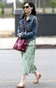 Zooey deschanel s green patterned maxi dress with denim jacket and bow