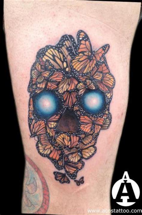 arm totenkopf schmetterling tattoo von andres acosta
