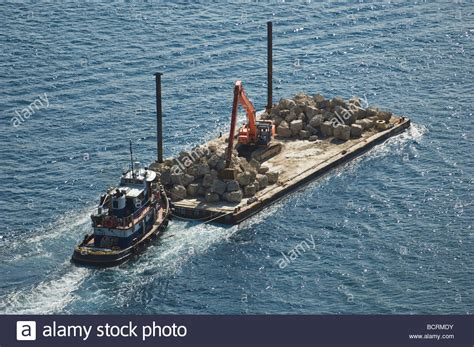 tugboat pushing barges tugboat pushing loaded barge in ocean stock photo royalty