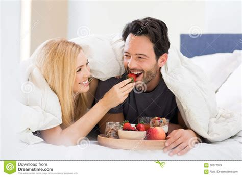 eating in bed couple eating breakfast on bed stock image image 68277179