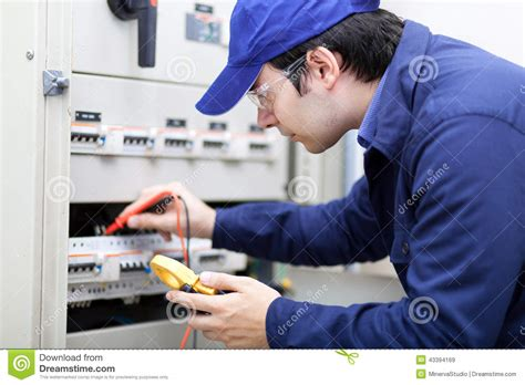 professional electrician while working stock photo image 43394169