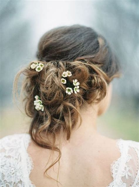 picture   messy updo  tiny fresh flowers tucked