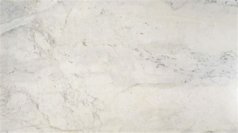 Soapstone Density Calacatta Gold Marble Is A Black White And Grey Veiny Stone