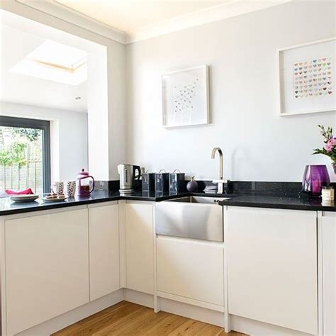 Belfast Sink In Modern Kitchen this white kitchen has been given a contemporary feel with