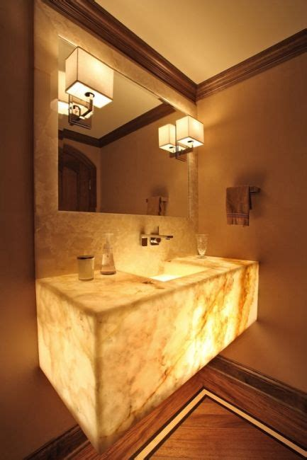 the floating onyx vanity with backlighting sets the tone