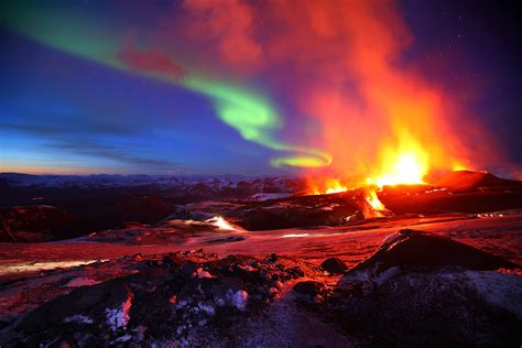 pictures of lava ls northern lights paint sky over arctic volcano wired