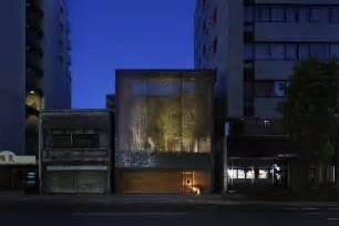 a garden enclosed by 6000 glass blocks optical glass