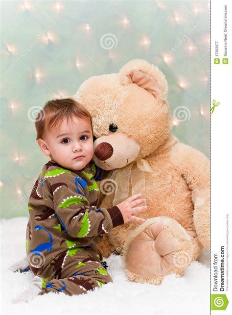 Pjhb85864 Pajamas Hug A Baby baby in pajamas hugging teddy royalty free