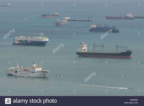 boat shipping singapore cargo boats tankers and container ships off the port of