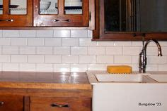 22 light grey subway white grout with decorative line the tile is a simple 3 215 6 subway tile from home depot it s