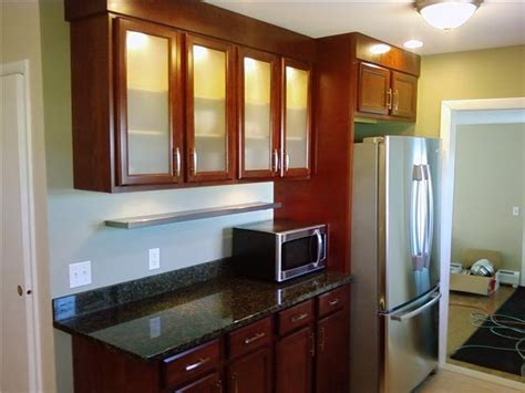 kitchen cabinets with glass doors cherry cabinets and backlit frosted glass doors reinke