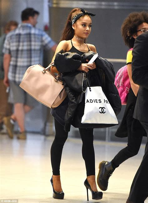 ariana grande in cute head scarf and sky high stilettos