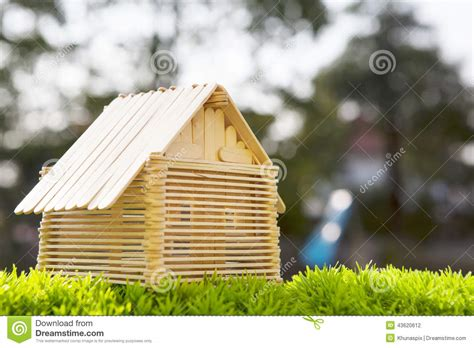 house model make from wood stick on artificial gra stock