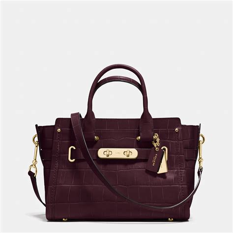 Coach Swagger Glovetanned Leather Oxblood 27 coach swagger 27 in croc embossed leather lyst