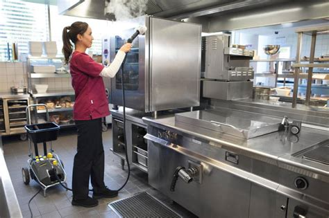 cleaning a kitchen deep steam cleaning to retain commercial kitchens clean
