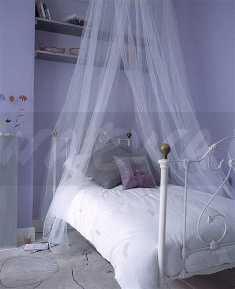 curtain over bed image sheer white voile curtains above white wrought iron
