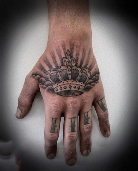 hand tattoo for men 67 most powerful crown tattoos for