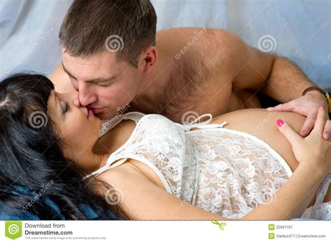 people kissing in bed pregnant couple kissing stock image image of family