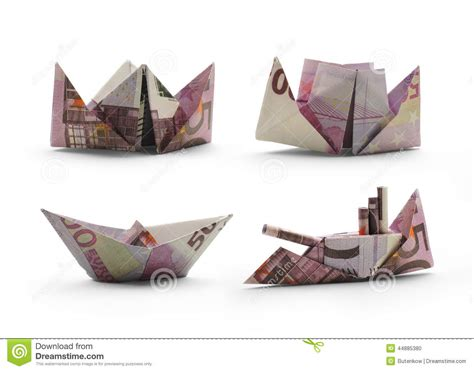 Origami Ships - origami ships of five hundred banknotes stock photo