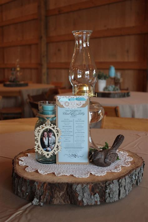 antique ls used as one of 4 different centerpieces our backyard wedding