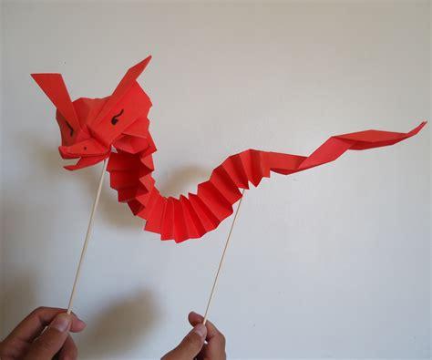De Origami - tiny origami puppet peque 241 o drag 243 n marioneta de