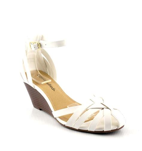 white closed toe sandals white soo caged closed toe low mid wedge sandals