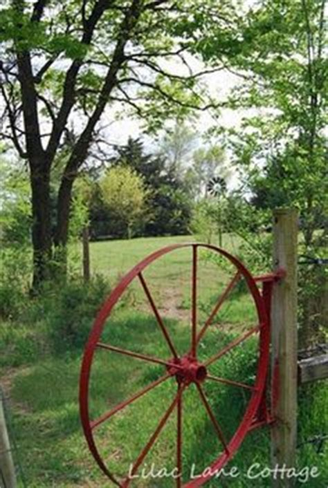 hay rake wheel repurposed as a garden gate garden ideas gardens vines and