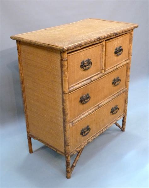 Small Wicker Chest Of Drawers by An Edwardian Bamboo And Wicker Chest Of Drawers Stock