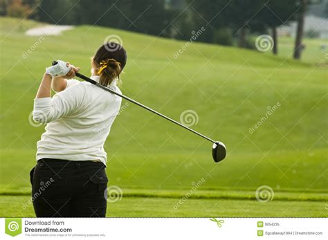swinging a driver lady golfer swinging driver royalty free stock photo