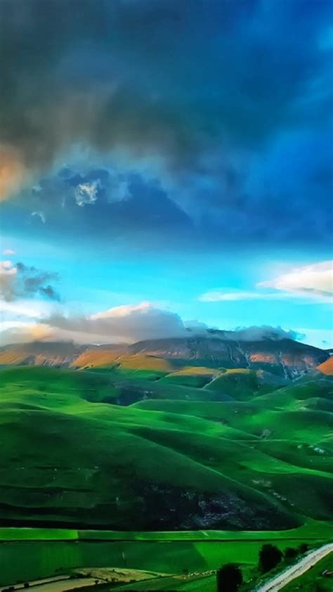 italy castelluccio  norcia clouds fields green wallpaper